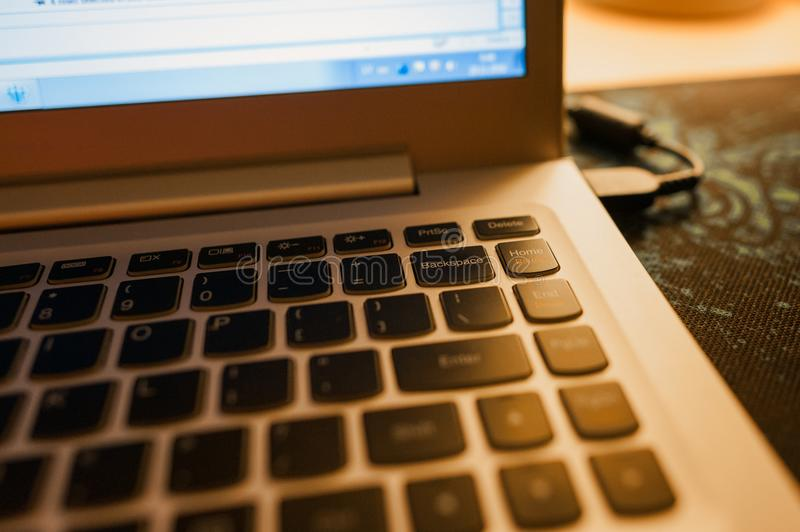 Close-up of laptop keyboard with focus on Backspace button and highlighted with warm evening light royalty free stock images