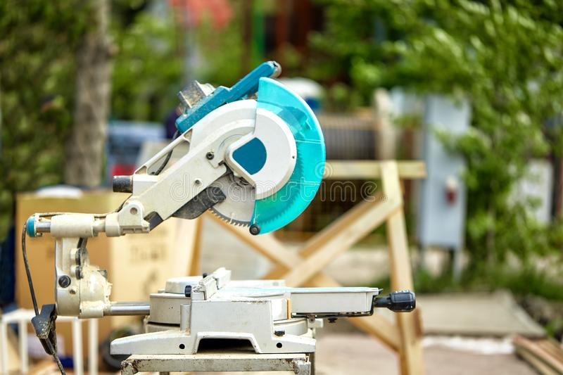 Close-up of a laser circular saw at a construction site. Products for home and garden and production. Building tool. stock photos