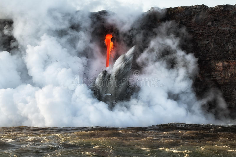 Close up of lava entry into ocean at Hawaii stock photo