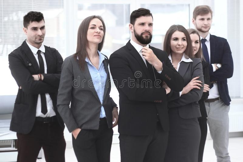 Close up.leader and business team standing together and looking at copy space royalty free stock photo