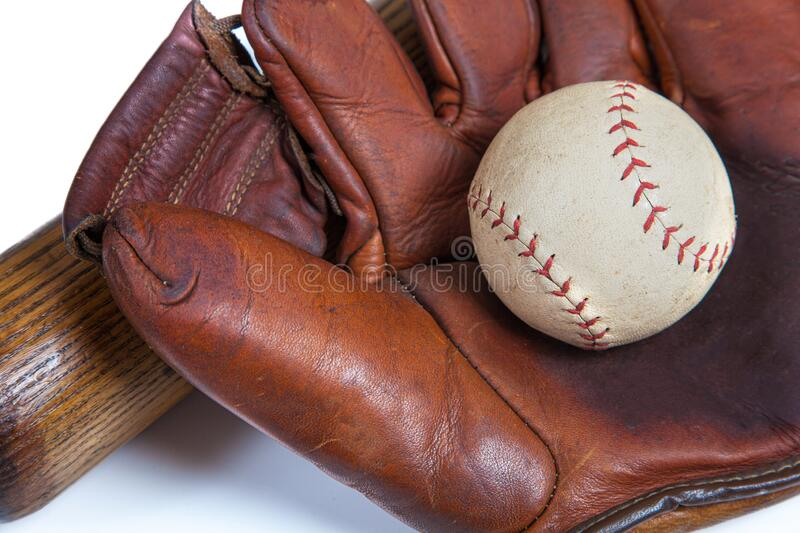 A close up of a Leather baseball glove, ball an wooden bat royalty free stock image