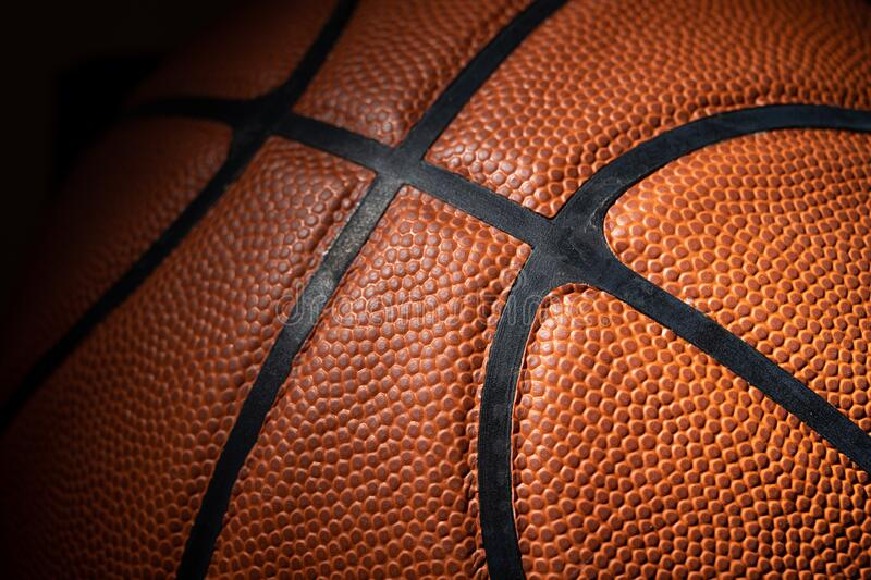 A close-up of a leather basketball on white royalty free stock images
