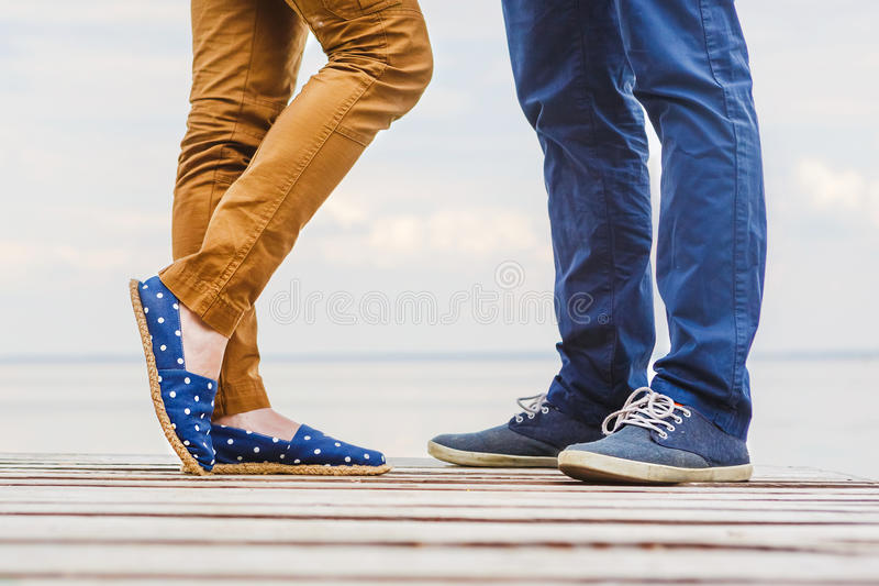 Close-up of legs of the kissing couple royalty free stock images