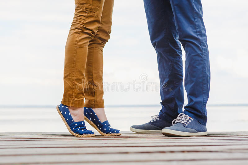 Close-up of legs of the kissing couple royalty free stock photography