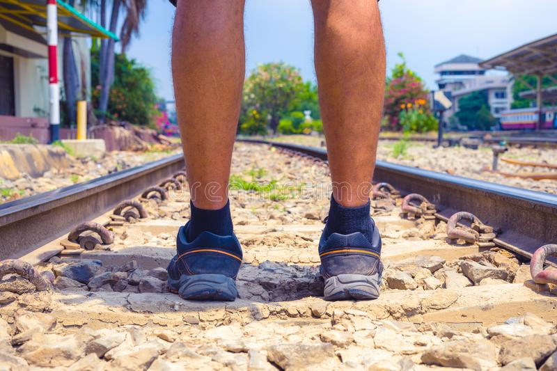 Close up of legs of traveler starting holidays from railway track in day . . royalty free stock photography