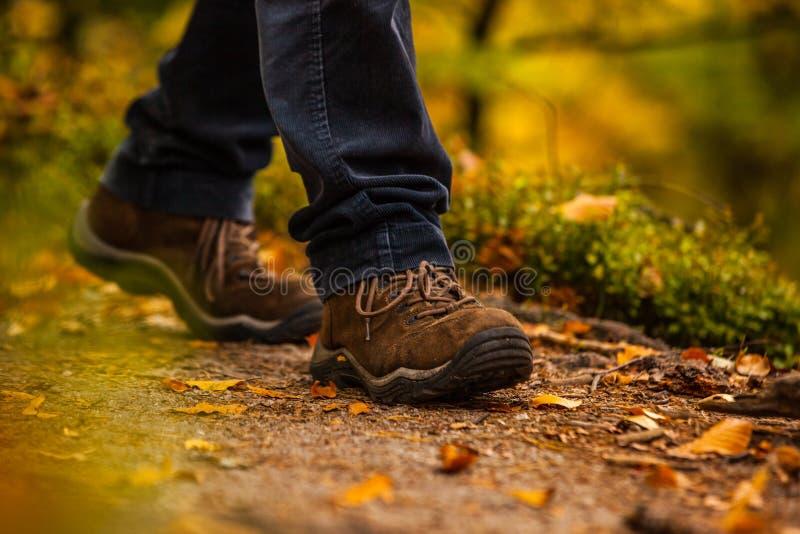 Close Up Of Legs Walking In Narrow Walkway Stock Image