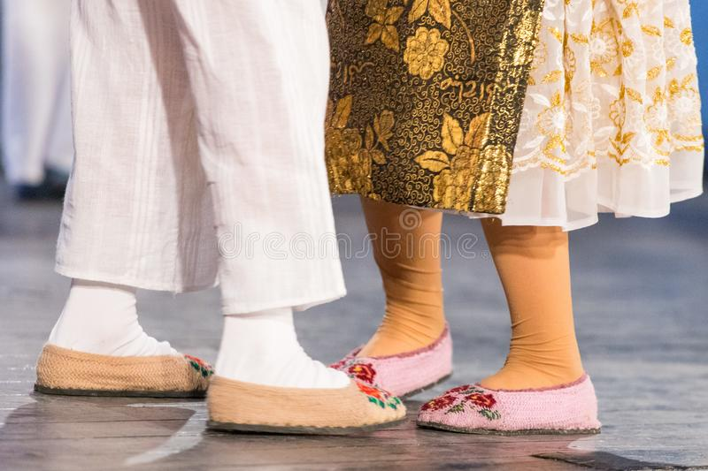 Close up of legs of young Romanian dancers perform a folk dance in traditional folkloric costume. Folklore of Romania.  royalty free stock image