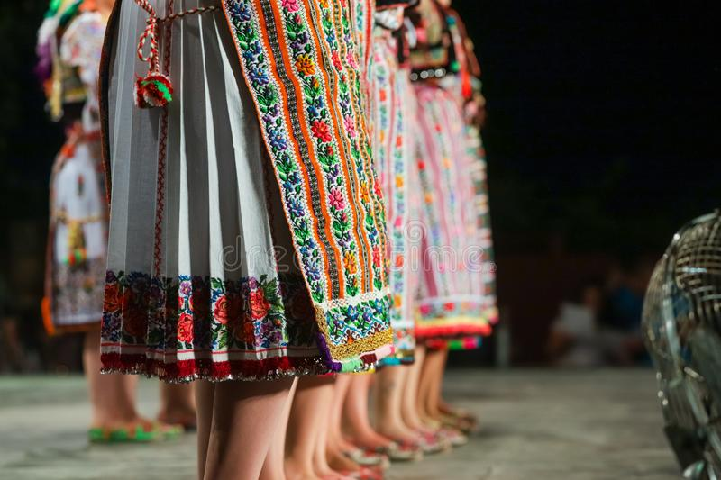 Close up of legs of young Romanian female dancers in traditional folkloric costume. Folklore of Romania royalty free stock photos