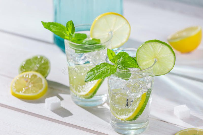 Close-up on lemon drink with ice royalty free stock photos