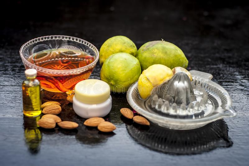 Badam ubtan or face pack of almon with all ingredients on wooden surface. stock image