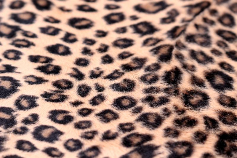 Leopard Print Pattern. Close up of leopard spots faux fur stock photography
