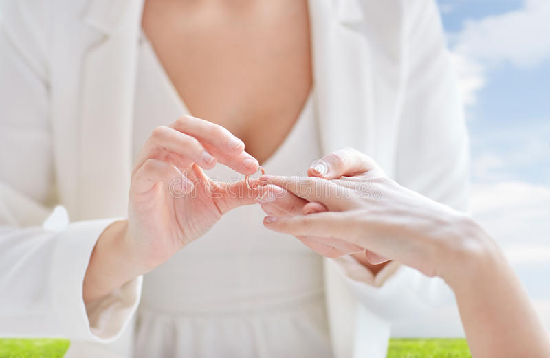 Close up of lesbian couple hands with wedding ring royalty free stock images