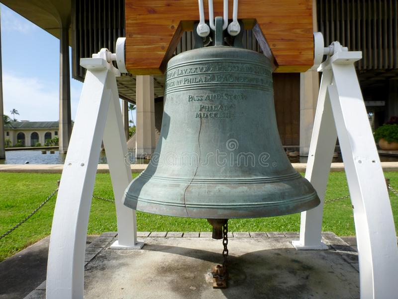 Close-up of Liberty Bell in front of the Hawaii State Capitol. In 1950, the United States Department of the Treasury assisted by several private companies royalty free stock image