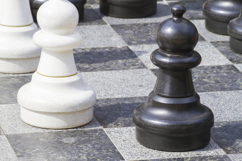 Close up of life sized chess pieces royalty free stock photo