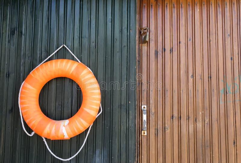 Close-up of a lifebelt on a wooden door. Close-up of a lifebelt on a wooden door stock photos