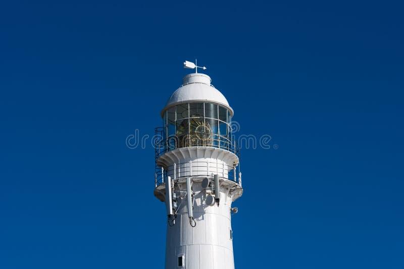 Close up of a lighthouse against a blue sky. A lighthouse against blue sky in Kommetjie, Cape Town, South Africa stock photos