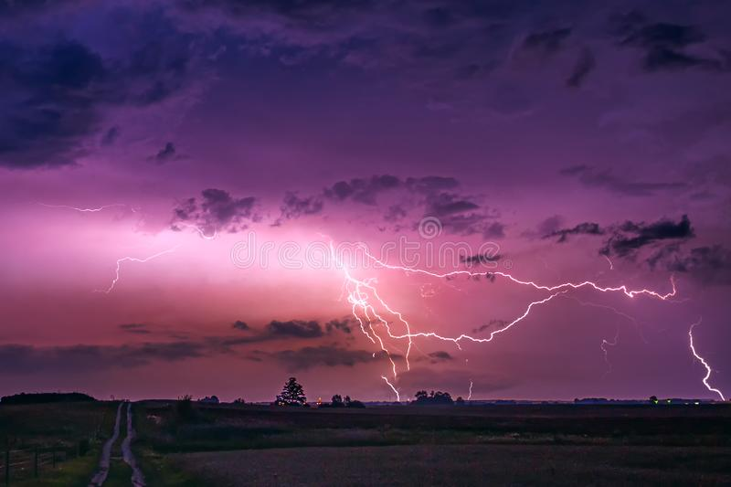 CLose up with lightning with dramatic clouds composite image . Night thunder-storm royalty free stock photography