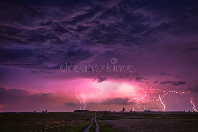 CLose up with lightning with dramatic clouds composite image . Night thunder-storm stock photography