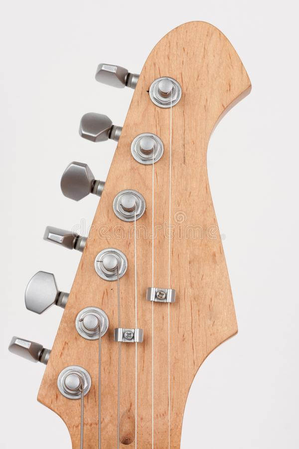 Close up of lightweight chrome tuning machines on neck of electric guitar, studio shoot royalty free stock images