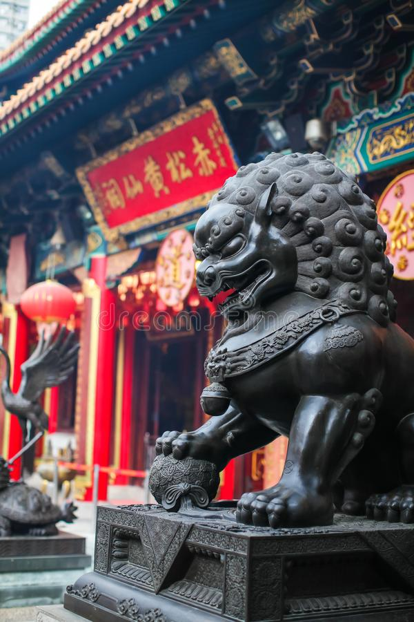 Close up Lion Guardian bronze sculpture at the Sik Sik Yuen Wong Tai Sin Temple in Kowloon, Hong Kong. stock images