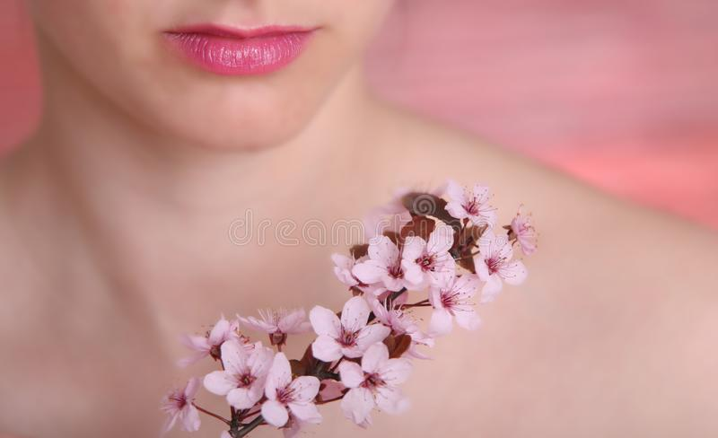 Close-up of lips and flowers stock photography