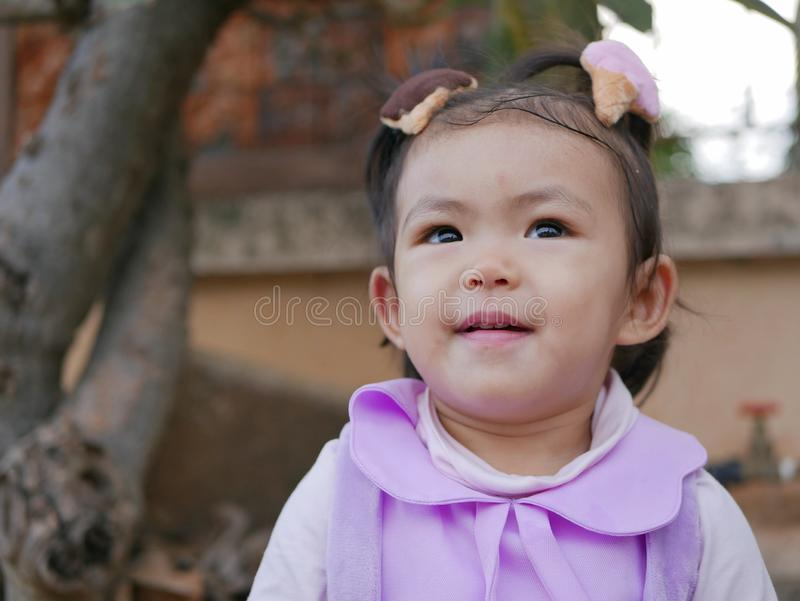 Close up of little Asian baby girl smiling and being happy stock photo