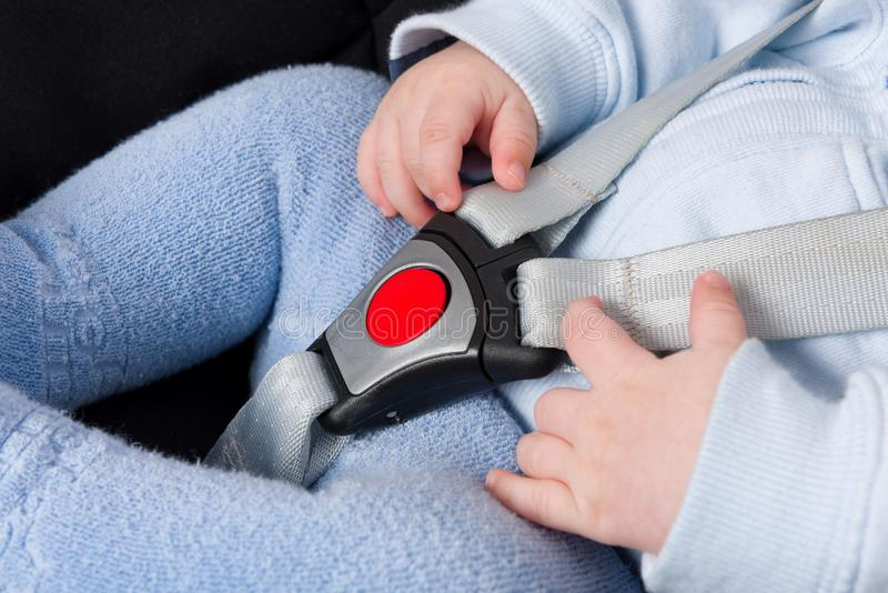 Close up on little boy in baby car seat protected with safety stock photo