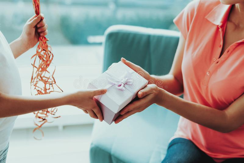 Close-up. Little Daughter Gives Present To Mum. Family Relationship. Active Holiday. Beautiful Moment. Surprise To Parent. Happy Childhood. Postcard In Hands royalty free stock images