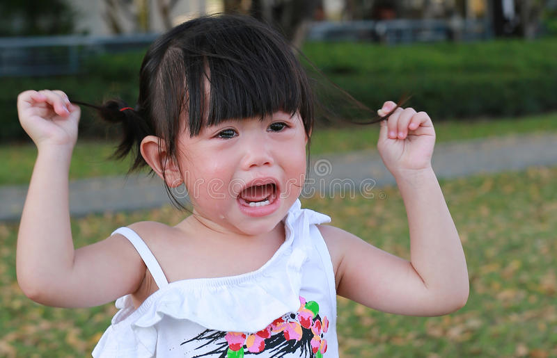 Close-up little girl crying royalty free stock image