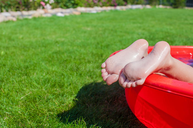 Download Close-up Of A Little Girl's Legs In The Pool Stock Image - Image of garden, green: 32915455
