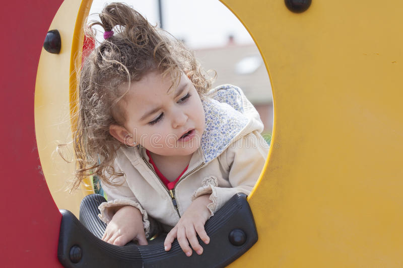 Close-up of little kid looking out of hole royalty free stock images