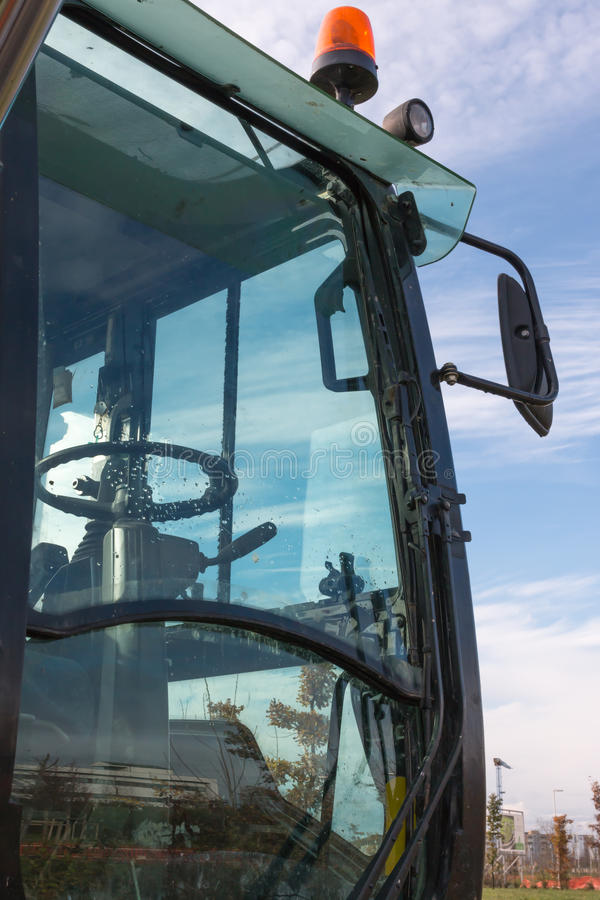 Close-up of loader excavator cabin with hazard lights royalty free stock photos