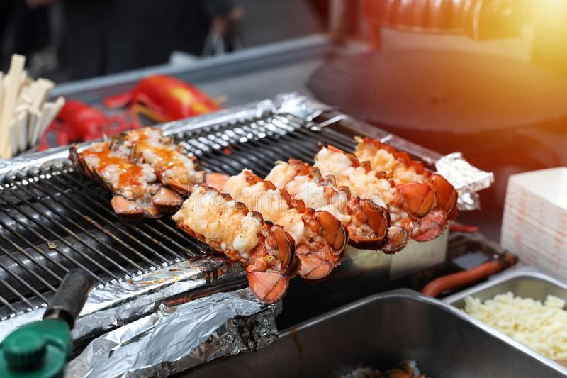 Close up Lobster burned on charcoal, street food royalty free stock photo