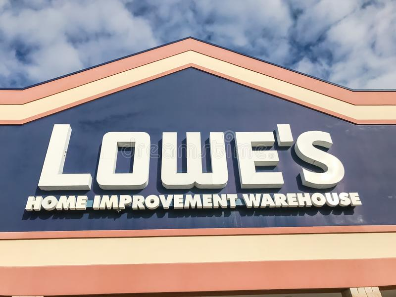 Close-up logo of Lowe's hardware store entrance under cloud blue sky stock images