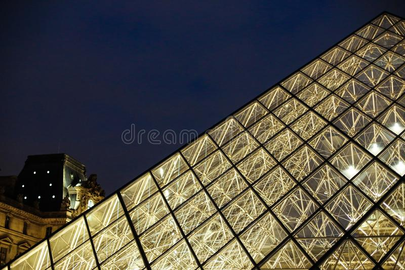 Close up Louvre amazing glass pyramid in night Paris, France. royalty free stock images