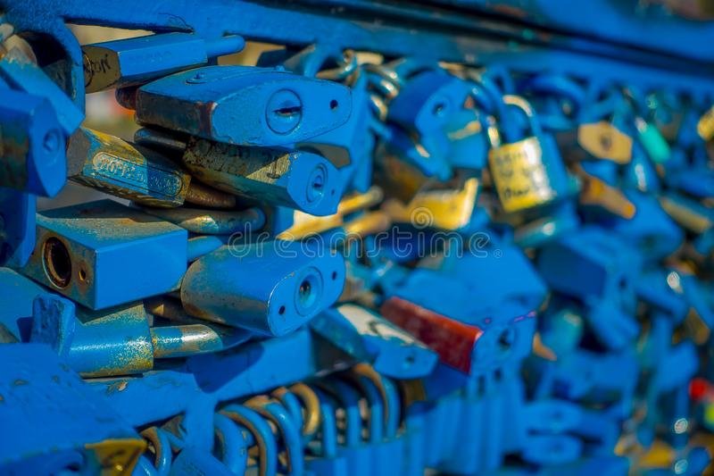Close up of love locks padlocks chained to footbridge over the river mapocho providencia Santiago Chile.  stock photography