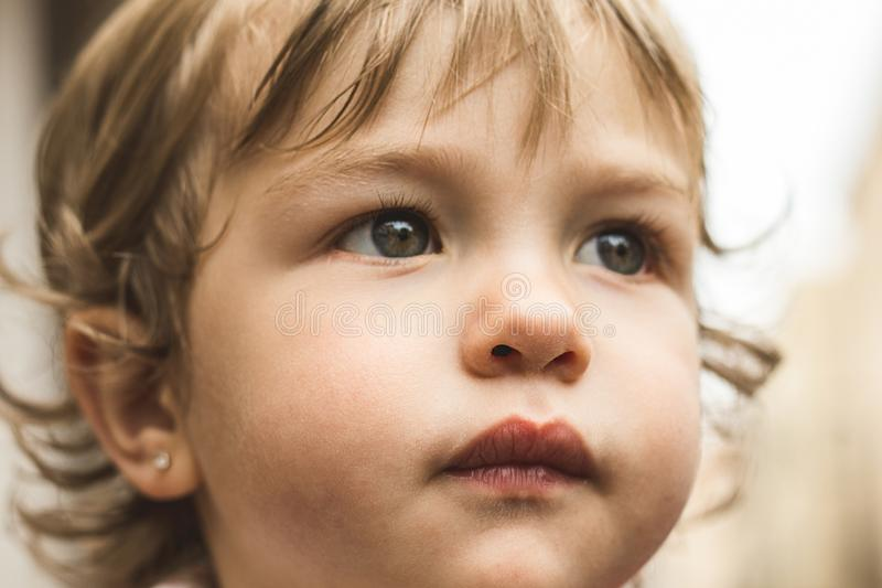 Close-up of a lovely child with beautiful eyes stock photo