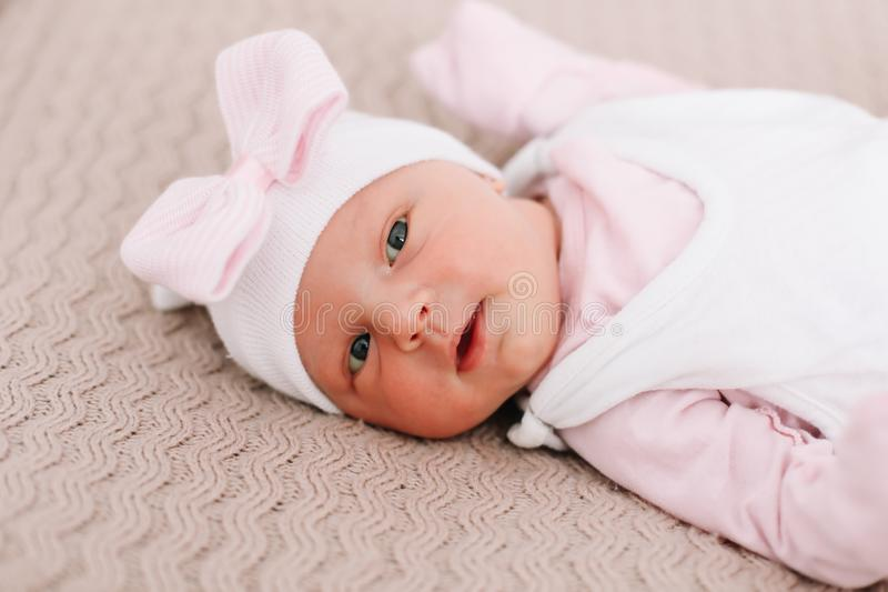 Close-up lovely newborn baby girl on a blanket. A portrait of a beautiful  newborn baby girl. A lovely newborn baby girl on a blanket. A portrait of a beautiful stock photo