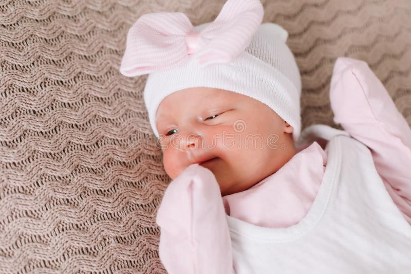 Close-up lovely newborn baby girl on a blanket. A portrait of a beautiful  newborn baby girl. A lovely newborn baby girl on a blanket. A portrait of a beautiful royalty free stock image