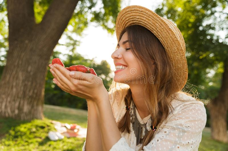 Close up of lovely young girl in summer hat spending time at the park, stock images