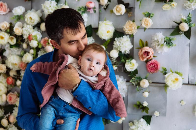 Close-up of a loving father kissing his baby daughter. The man became a father and cherishes his child. A gentle kiss royalty free stock images