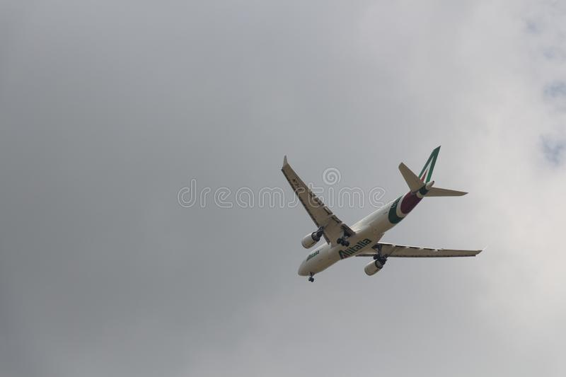 Close up of low flying aircraft in the sky royalty free stock image