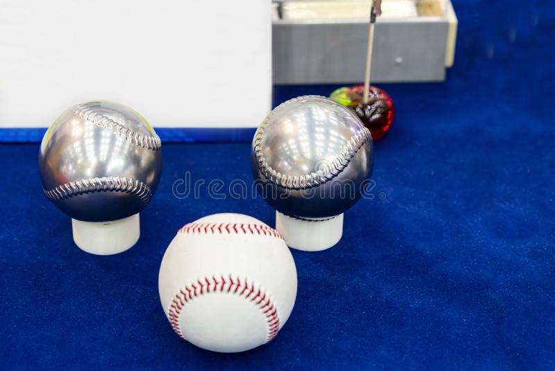 Close up machining metal or stainless steel parts two ball baseball make by automatic high technology accuracy and precision royalty free stock image