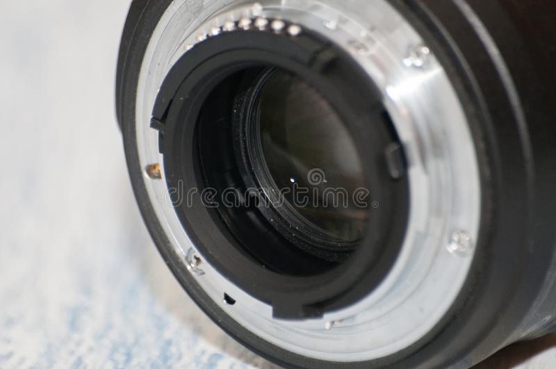 Close-up, macro, back part of camera lens, side view. Concept of camera, service center. There is a place for text stock photography