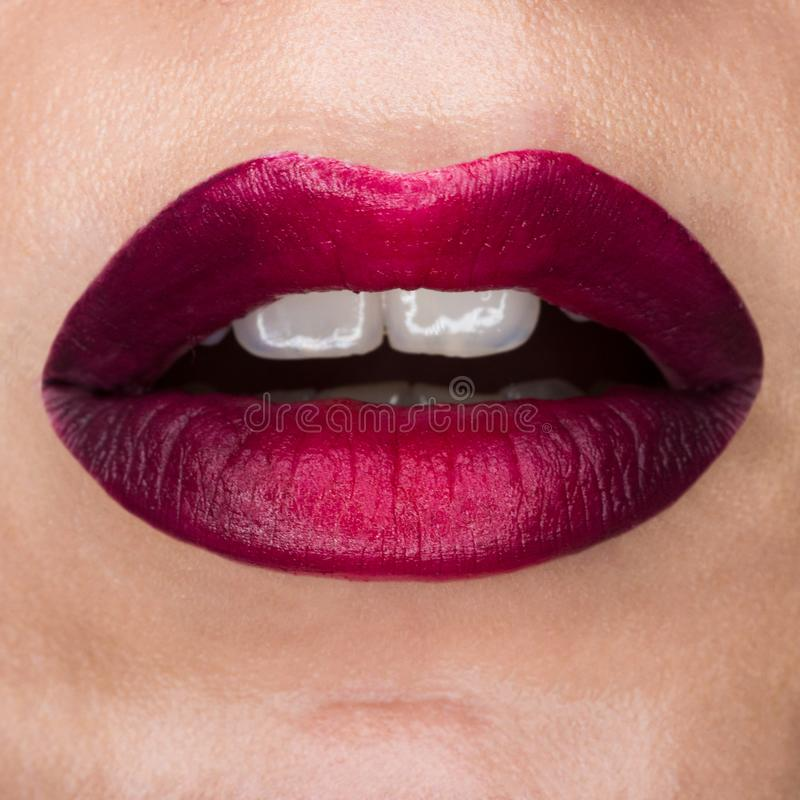 Close-up macro beautiful lips with red mat lipstick. Red gradient, white teeth and open mouth. Lip art stock images