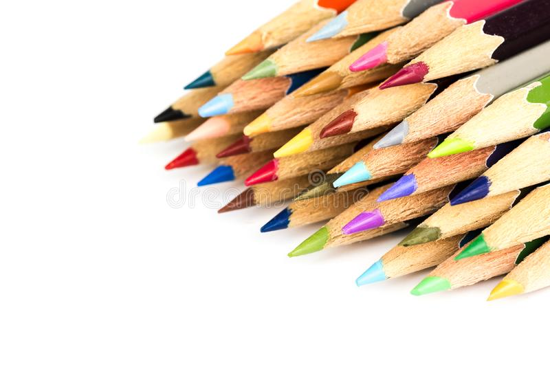 Close up macro of color pencil set on white background. Back to school concept stock photography