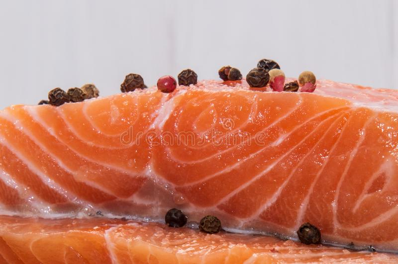 Close up, macro. Ingredients. Fresh salmon steak surrounded by spices. royalty free stock photos