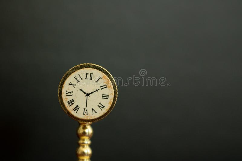 Picture of a vintage clock or watch showing the time. stock photos