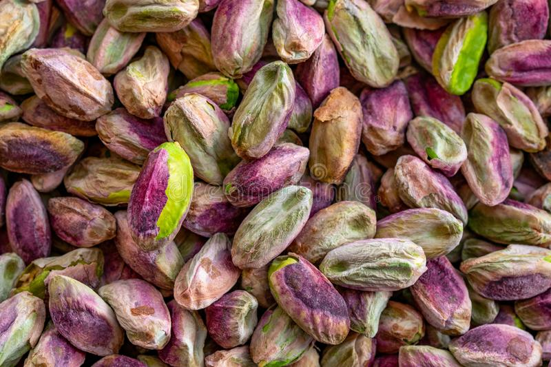 Close-up macro shot of roasted and shelled Australian pistachio nuts. These seeds have a mauve-colored skin and light green flesh and are widely considered to royalty free stock photos