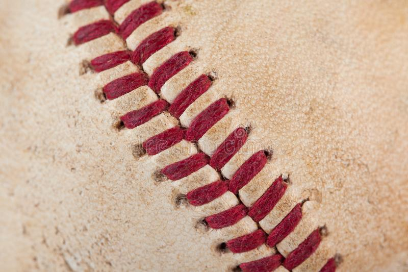 Close up macro view of red stitched seams of an worn baseball royalty free stock images